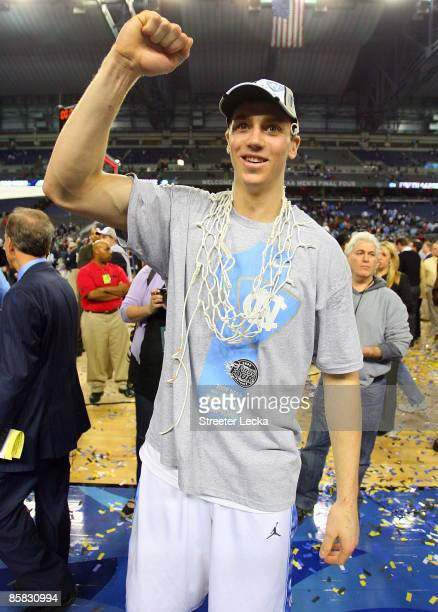 Tyler Hansbrough of the North Carolina Tar Heels celebrates as he wears the net over his neck after the Tar Heels 89-72 win against the Michigan...