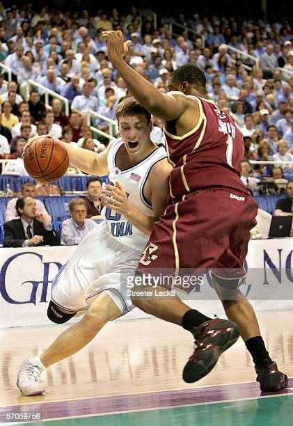 Tyler Hansbrough of the North Carolina Tar Heels drives against Craig Smith of the Boston College Eagles during the semifinals of the Atlantic Coast...