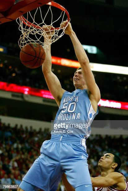 Tyler Hansbrough of the North Carolina Tar Heels dunks against Javier Gonzalez of the North Carolina State Wolfpack during the first half at RBC...