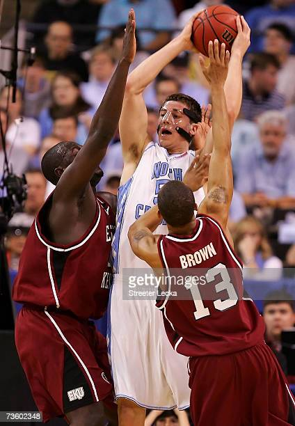 Tyler Hansbrough of the North Carolina Tar Heels is doubleteamed by Harrison Brown of the the Eastern Kentucky Colonels and another defender during...