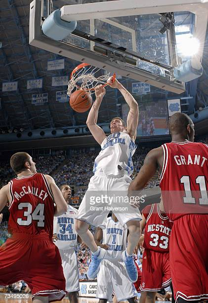 Tyler Hansbrough of the North Carolina Tar Heels makes a dunk against Ben McCauley of the North Carolina State Wolfpack on February 21 2007 at the...