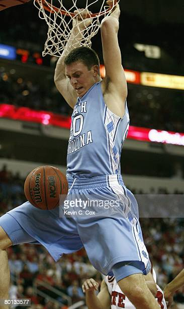 Tyler Hansbrough of the North Carolina Tar Heels makes a dunk against the North Carolina State Wolfpack during the game at RBC Center on February 20...