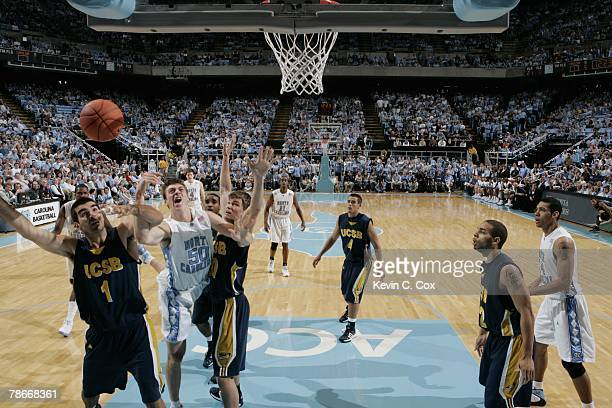 Tyler Hansbrough of the North Carolina Tar Heels reaches for the ball against Nedim Pajevic and Beau Gibb of the UC Santa Barbara Gauchos during the...