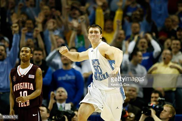Tyler Hansbrough of the North Carolina Tar Heels reacts after making the gamewinning shot with 8 seconds left as Hank Thorns of the Virginia Tech...
