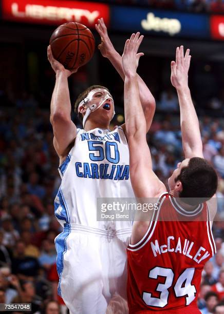 Tyler Hansbrough of the North Carolina Tar Heels shoots over Ben McCauley of the North Carolina State Wolfpack in the ACC Men's Basketball Tournament...