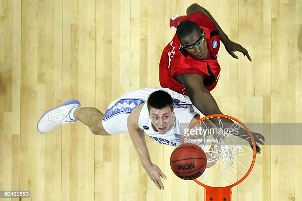 Tyler Hansbrough of the North Carolina Tar Heels waits for a rebound alongside Juan Palacios of the Louisville Cardinals during the 2008 NCAA Men's...
