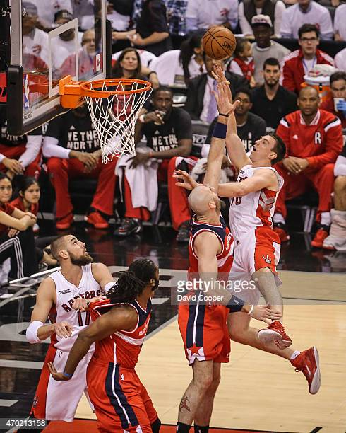 TORONTO ON APRIL 18 Tyler Hansbrough of the Toronto Raptors goes up over Marcin Gortat of the Washington Wizards to the hoop during the game between...