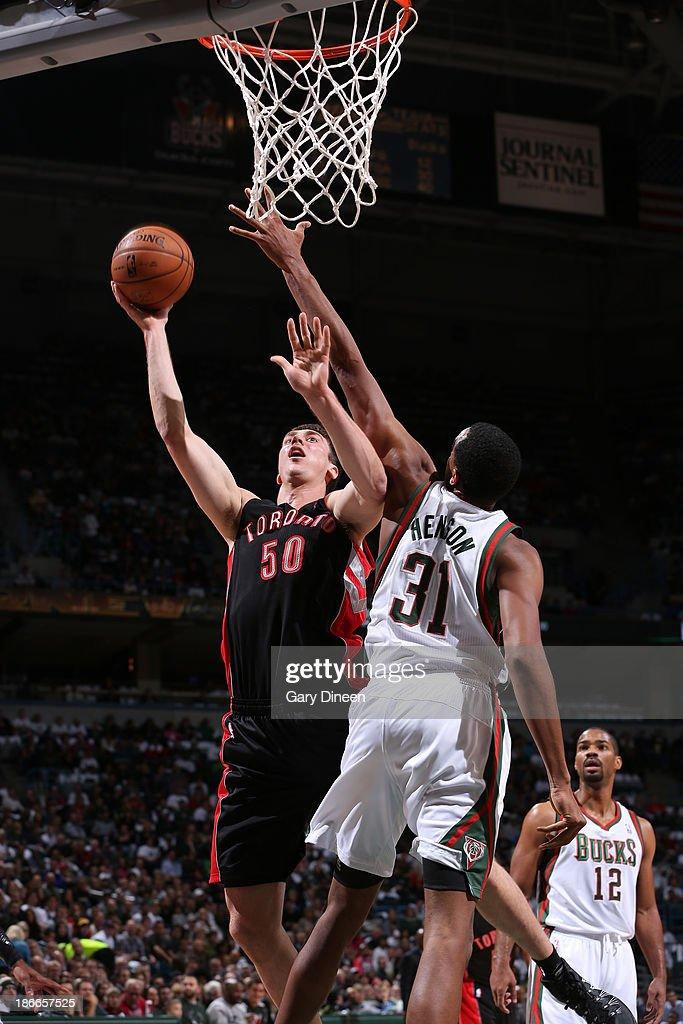 Tyler Hansbrough #50 of the Toronto Raptors shoots against John Henson #31 of the Milwaukee Bucks on November 2, 2013 at the BMO Harris Bradley Center in Milwaukee, Wisconsin.