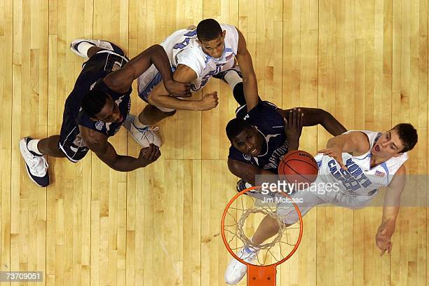 Tyler Hansbrough of the University of North Carolina Tar Heels goes to the hoop against Vernon Macklin of the Georgetown Hoyas during the NCAA Men's...