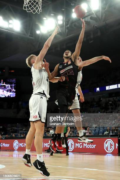 Tyler Harvey of the Hawks shoots under pressure during the NBL Cup match between the Illawarra Hawks and Melbourne United at John Cain Arena on March...