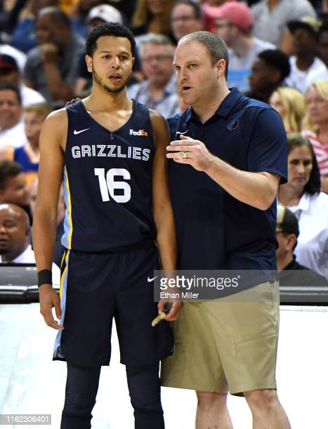 Tyler Harvey of the Memphis Grizzlies talks to his head coach Taylor Jenkins during the championship game of the 2019 NBA Summer League against the...