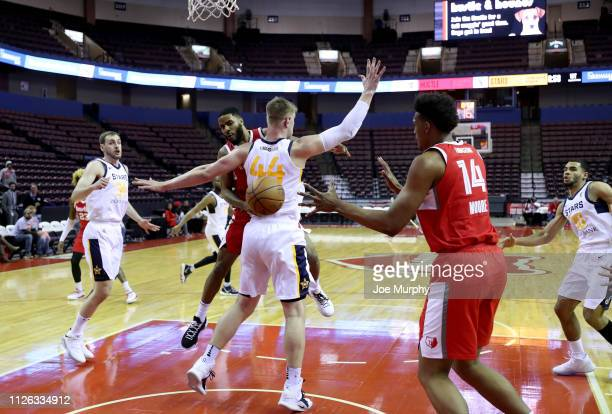 Tyler Harvey the Memphis Hustle passes the ball against Isaac Haas of the Salt Lake City Stars during an NBA GLeague game on February 20 2019 at...