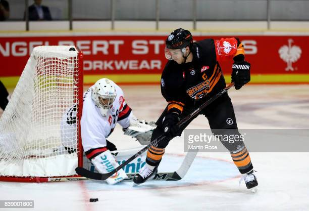 Tyler Haskins of Wolfsburg fails to score over Jan Lukas goaltender of Bystrica during the Champions Hockey League match between Grizzlys Wolfsburg...