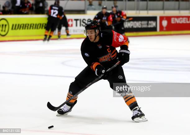 Tyler Haskins of Wolfsburg skates against Banska Bystrica during the Champions Hockey League match between Grizzlys Wolfsburg and HC05 Banska...
