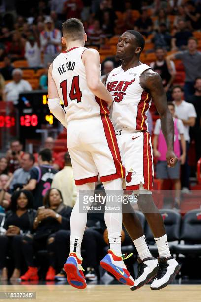 Tyler Herro and Kendrick Nunn of the Miami Heat celebrate after a dunk against the Memphis Grizzlies during the second half at American Airlines...
