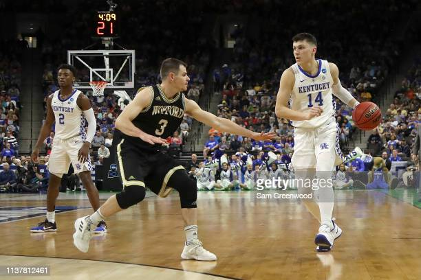 Tyler Herro of the Kentucky Wildcats drives against Fletcher Magee of the Wofford Terriers during the first half of the game in the second round of...