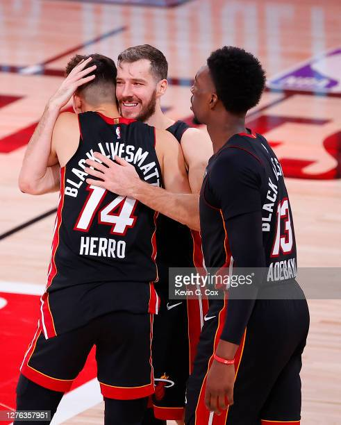 Tyler Herro of the Miami Heat and Goran Dragic of the Miami Heat react after their win over the Boston Celtics in Game Four of the Eastern Conference...