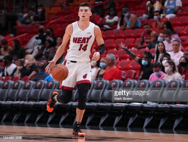 Tyler Herro of the Miami Heat dribbles the ball up the court against the Atlanta Hawks in the third quarter of preseason action at FTX Arena on...