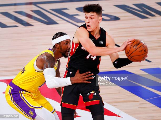 Tyler Herro of the Miami Heat drives the ball against Kentavious Caldwell-Pope of the Los Angeles Lakers during the second quarter in Game Four of...