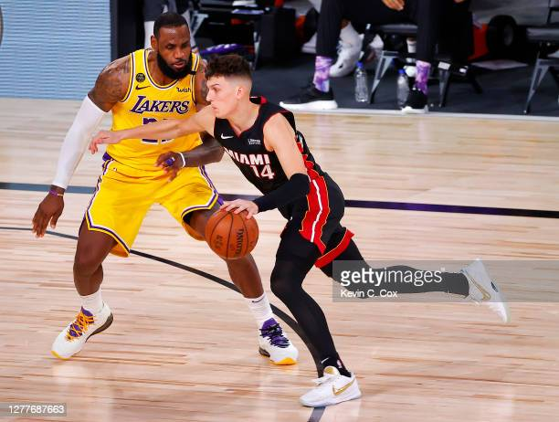 Tyler Herro of the Miami Heat drives the ball against LeBron James of the Los Angeles Lakers during the fourth quarter in Game One of the 2020 NBA...