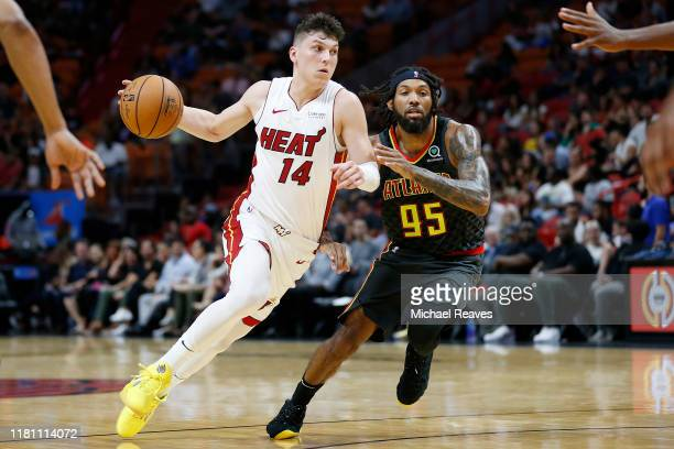 Tyler Herro of the Miami Heat drives to the basket against DeAndre' Bembry of the Atlanta Hawks during the second half of the preseason game at...