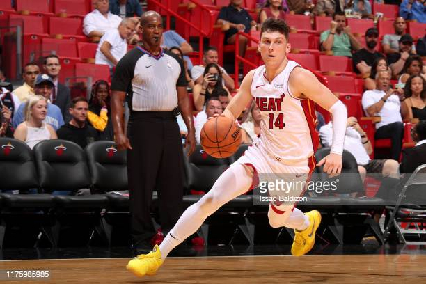 Tyler Herro of the Miami Heat handles the ball against the Atlanta Hawks during a preseason game on October 14 2019 at American Airlines Arena in...