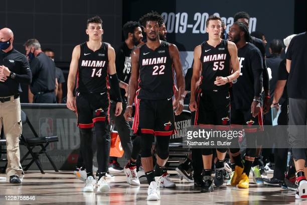 Tyler Herro of the Miami Heat, Jimmy Butler of the Miami Heat and Duncan Robinson of the Miami Heat look on during the game against the Boston...