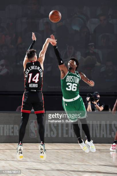 Tyler Herro of the Miami Heat shoots a three point basket while Marcus Smart of the Boston Celtics plays defense during Game Four of the Eastern...