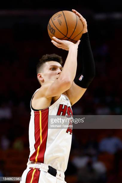 Tyler Herro of the Miami Heat shoots a three pointer during the first quarter of a preseason game against the Boston Celtics at FTX Arena on October...
