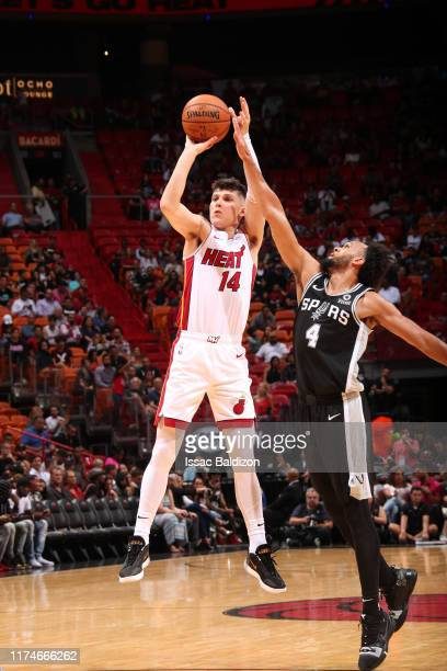 Tyler Herro of the Miami Heat shoots three point basket against the San Antonio Spurs on October 8 2019 at American Airlines Arena in Miami Florida...