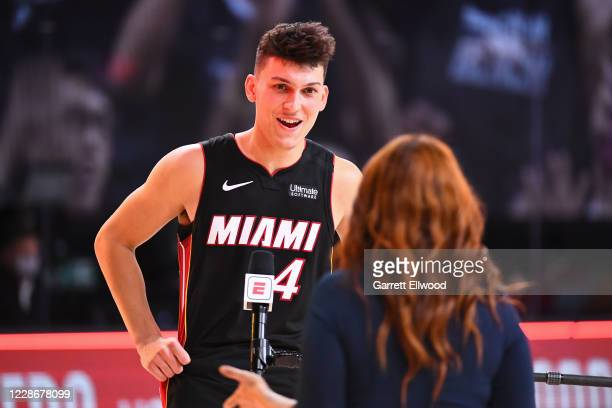 Tyler Herro of the Miami Heat smiles and talks the media on the court after Game Four of the Eastern Conference Finals against the Boston Celtics on...