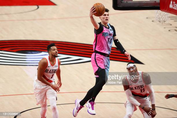 Tyler Herro of the Miami Heat takes a shot in the second quarter against the Portland Trail Blazers at Moda Center on April 11, 2021 in Portland,...