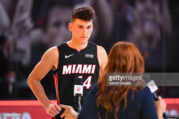 Tyler Herro of the Miami Heat talks the media on the court after Game Four of the Eastern Conference Finals against the Boston Celtics on September...