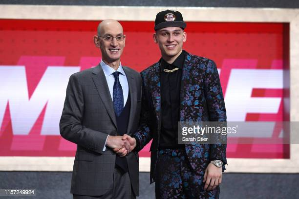 Tyler Herro poses with NBA Commissioner Adam Silver after being drafted with the 13th overall pick by the Miami Heat during the 2019 NBA Draft at the...