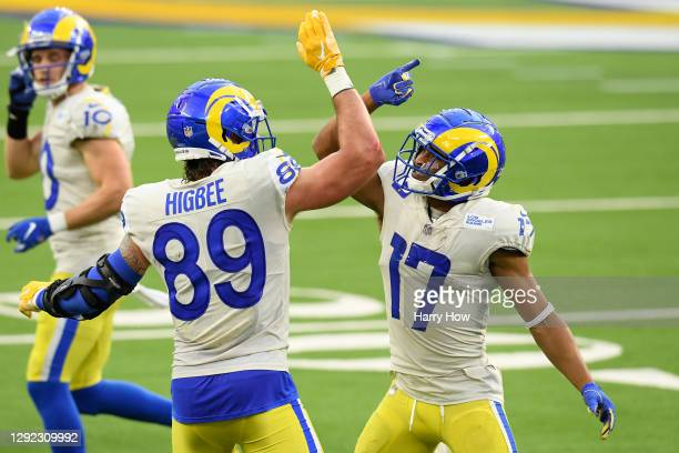 Tyler Higbee and Robert Woods of the Los Angeles Rams celebrate a touchdown during the third quarter of a game against the New York Jets at SoFi...