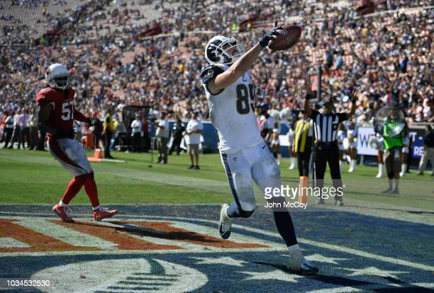 Tyler Higbee of the Los Angeles Rams celebrates a touchdown against the Arizona Cardinals in the fourth quarter at Los Angeles Memorial Coliseum on...