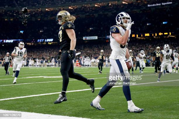 Tyler Higbee of the Los Angeles Rams celebrates after scoring a touchdown against the New Orleans Saints during the third quarter in the NFC...