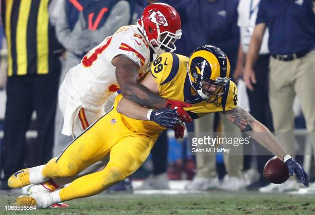 Tyler Higbee of the Los Angeles Rams fumbles on a short pass during the third quarter of the game against the Kansas City Chiefs at Los Angeles...