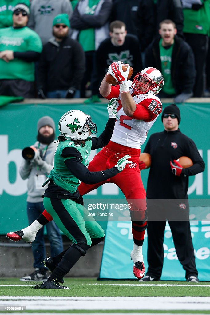 Tyler Higbee #82 of the Western Kentucky Hilltoppers makes an 11-yard touchdown reception in the first half of the game against the Marshall Thundering Herd at Joan C. Edwards Stadium on November 28, 2014 in Huntington, West Virginia.