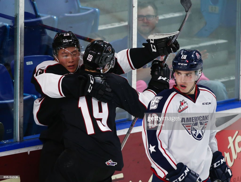 Tyler Ho #23 of the Vancouver Giants celebrates his goal against the Tri-City Americans with teammate Dawson Holt #19 during the second period of their WHL game at the Langley Events Centre on October 6, 2017 in Langley, British Columbia, Canada.