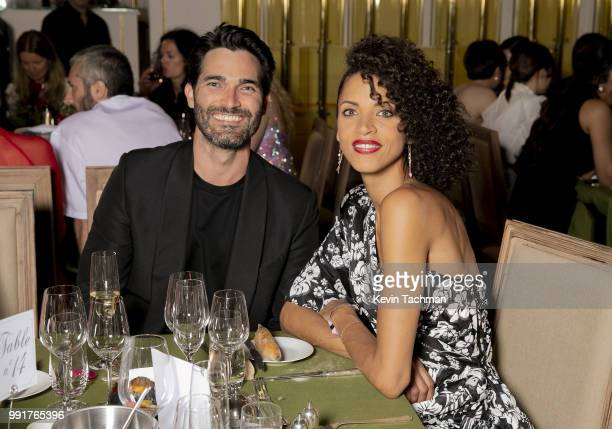 Tyler Hoechlin and Noemie Lenoir attends the amfAR Paris Dinner at The Peninsula Hotel on July 4 2018 in Paris France