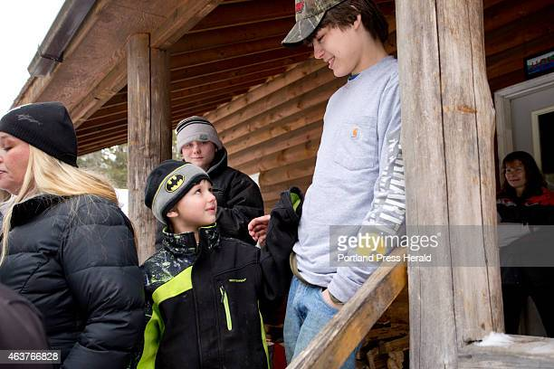 Tyler HowardGotto at right laughs with his little brother Gauge HowardFowler Tuesday February 17 2015 at his grandfather's house in Andover after...