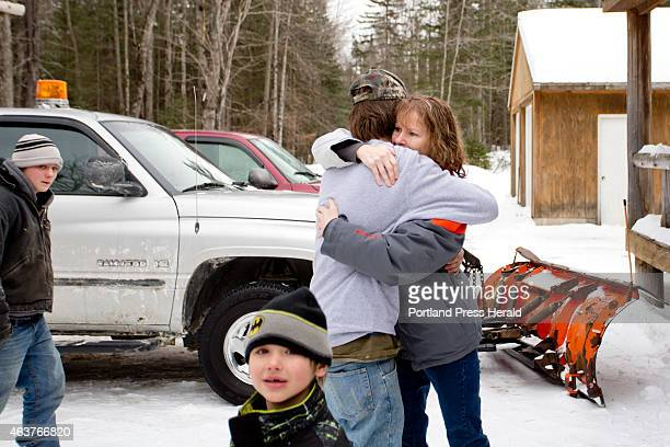 Tyler HowardGotto hugs his aunt Caroline Flynn after HowardGotto returned to his grandfather's house safely Tuesday February 17 2015 after spending a...