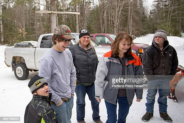 Tyler HowardGotto laughs with his little brother Gauge HowardFowler Tuesday February 17 2015 at his grandfather's house in Andover after returning...