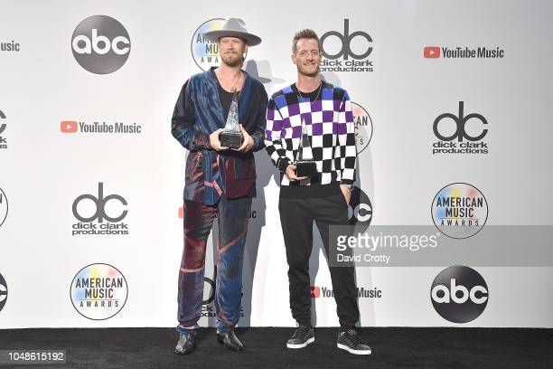 Tyler Hubbard and Brian Kelley attend the 2018 American Music Awards Press Room at Microsoft Theater on October 9 2018 in Los Angeles California