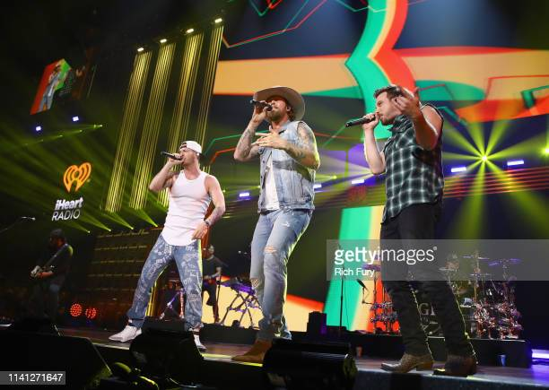 Tyler Hubbard and Brian Kelley of Florida Georgia Line and Morgan Wallen perform onstage during the 2019 iHeartCountry Festival Presented by Capital...