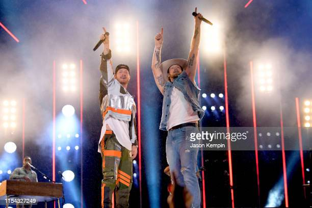 Tyler Hubbard and Brian Kelley of Florida Georgia Line perform on stage during day 1 of 2019 CMA Music Festival on June 06 2019 in Nashville Tennessee