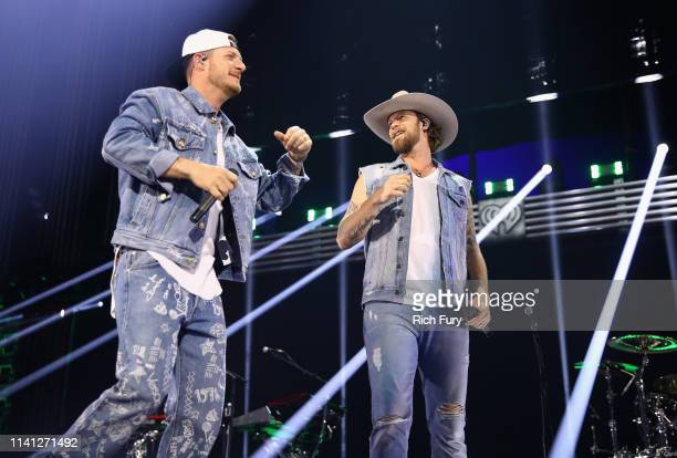 Tyler Hubbard and Brian Kelley of Florida Georgia Line perform onstage during the 2019 iHeartCountry Festival Presented by Capital One at the Frank...