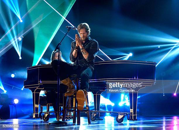 Tyler Hubbard and Brian Kelley of Florida Georgia Line perform onstage during the 2016 American Country Countdown Awards at The Forum on May 1 2016...