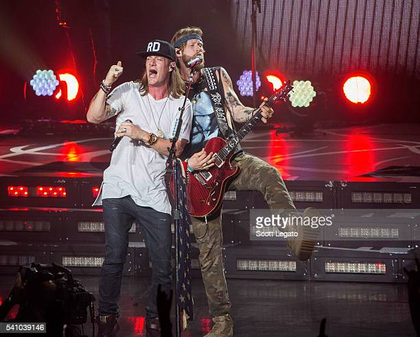 Tyler Hubbard and Brian Kelley of Florida Georgia Line performs during the Dig Your Roots Tour 2016 at DTE Energy Center on June 17 2016 in Clarkston...
